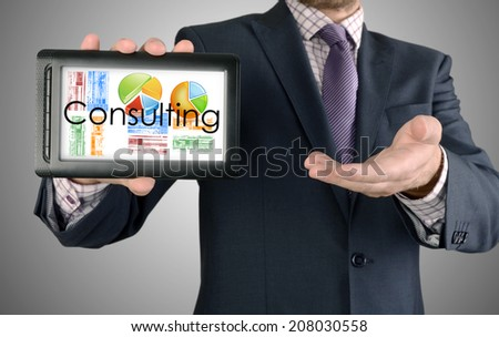 Businessman showing business concept on tablet - Consulting