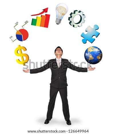 Businessman showing business symbols isolated on white backgroun - stock photo