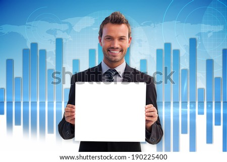 Businessman showing card against global business graphic in blue - stock photo