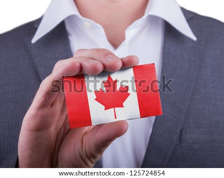 Businessman showing card, matte paper effect, Canada - stock photo