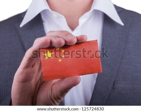 Businessman showing card, matte paper effect, China - stock photo