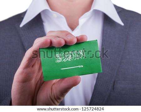 Businessman showing card, matte paper effect, Saudi Arabia - stock photo