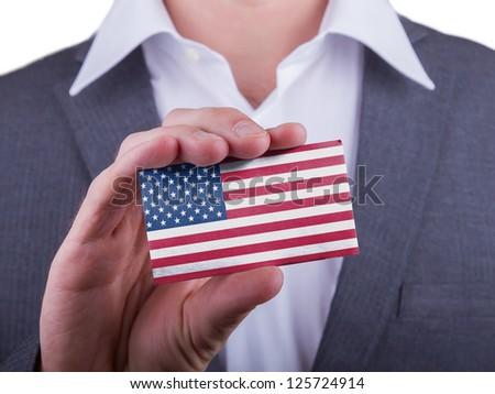 Businessman showing card, matte paper effect, USA - stock photo