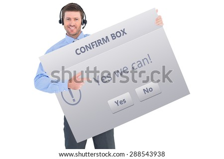 Businessman showing card wearing headset against confirm box - stock photo