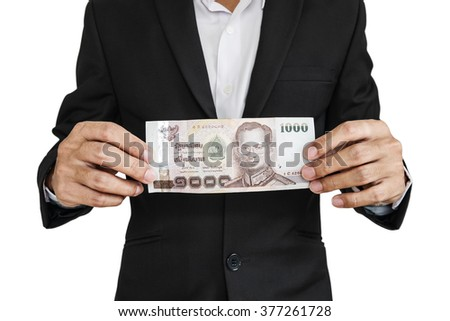 Businessman showing cash, isolated on white background