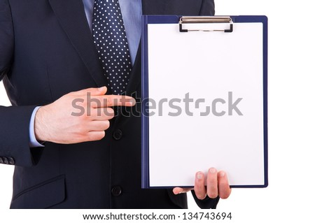 Businessman showing clipboard.