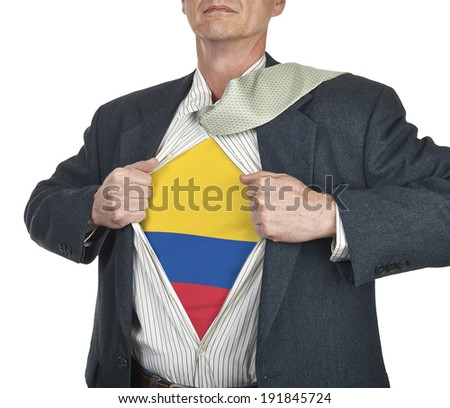 Businessman showing Colombia flag superhero suit underneath his shirt standing against white background - stock photo