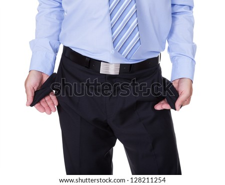 Businessman Showing Empty Pockets On White Backgrounds - stock photo