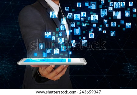 businessman showing glow user icon floating from tablet screen