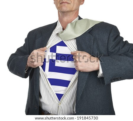 Businessman showing Greece flag superhero suit underneath his shirt standing against white background - stock photo