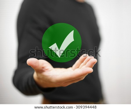 Businessman showing green check mark. Concept of correct decision - stock photo
