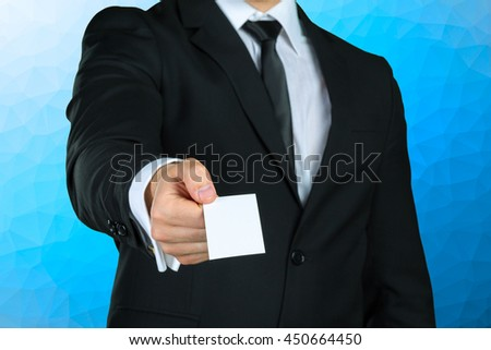 Businessman showing his business card - stock photo