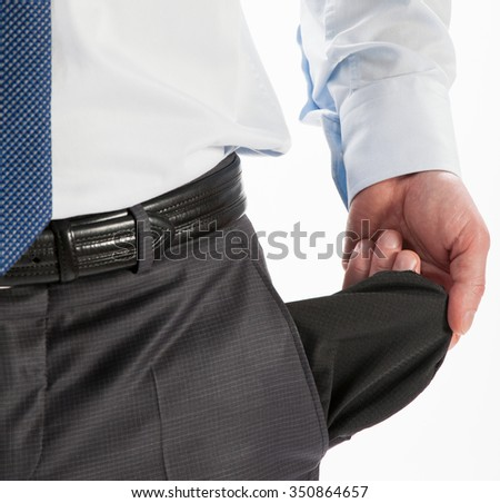 Businessman showing his empty pocket - closeup shot