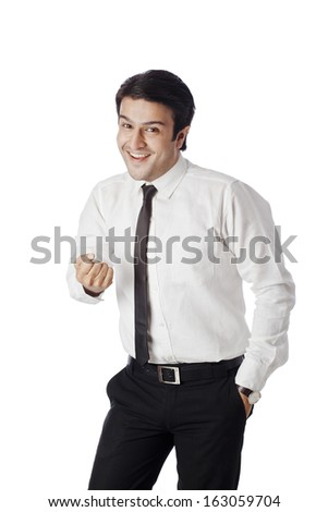 Businessman showing his fist and smiling - stock photo