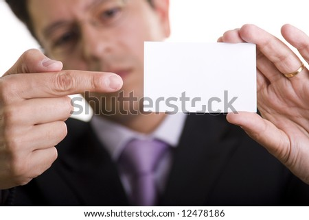 Businessman showing is blank card with copy space (selective and soft focus) - stock photo