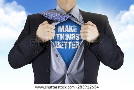 businessman showing Make things better words underneath his shirt over blue sky - stock photo