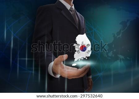 Businessman showing map of Australia on globe background - stock photo