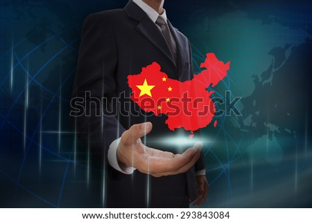 Businessman showing map of China on globe background