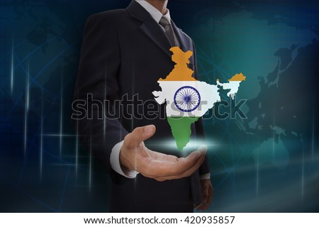 Businessman showing map of India on globe background