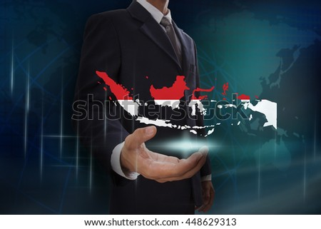 Businessman showing map of Indonesia on globe background