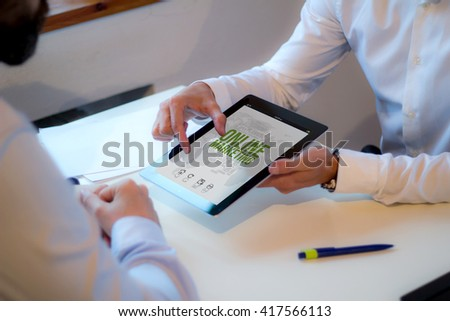 businessman showing marketing online strategy on a tablet in a business meeting. All screen graphics are made up.