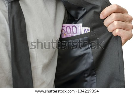 Businessman showing money in inner pocket of his suit. Concept of corrupted businessman. - stock photo