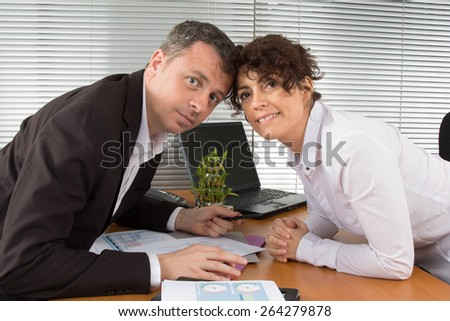 Businessman showing new strategy business documents at the office - stock photo