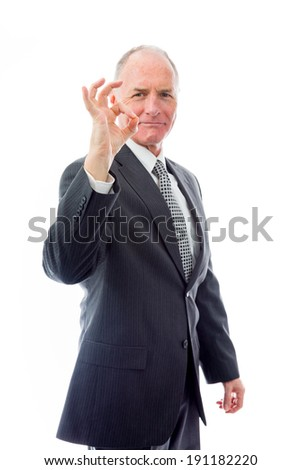 Businessman showing ok sign - stock photo