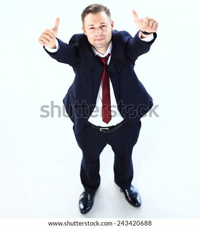 Businessman showing OK sign with his thumb up - stock photo