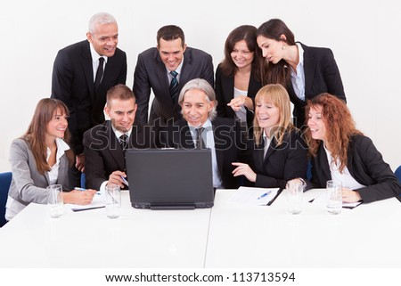 Businessman Showing On Laptop In Meeting With His Colleagues - stock photo