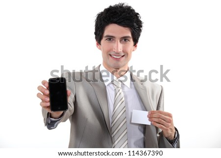Businessman showing phone and business card - stock photo