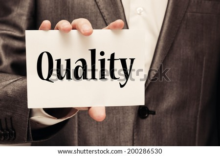 Businessman showing Quality Concept  - stock photo