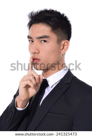 businessman showing silence gesture,