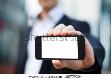 businessman showing smartphone with isolated screen - stock photo