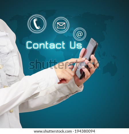 Businessman showing smartphone with  word contact us and icon on virtual screen. - stock photo