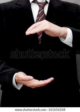 Businessman showing something - stock photo