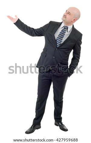 Businessman showing something, full length, isolated on white - stock photo