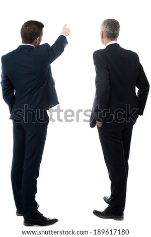 Businessman showing something to his partner - stock photo