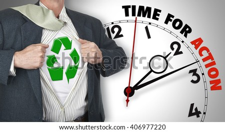 Businessman showing superhero suit with recyclable concept underneath his shirt standing against clock with time for action - path for the shirt - stock photo