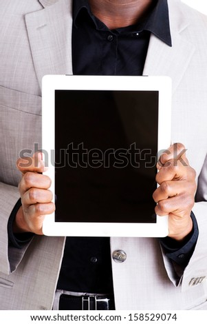 Businessman showing tablet computer - stock photo