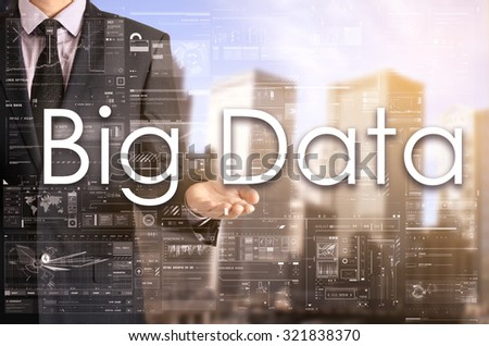 Businessman showing text by his hand: Big Data - stock photo
