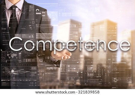 Businessman showing text by his hand: Competence - stock photo