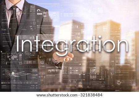 Businessman showing text by his hand: Integration - stock photo