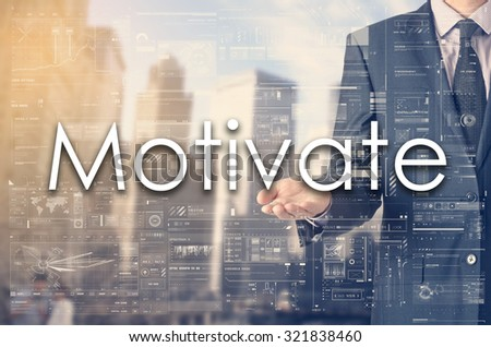 Businessman showing text by his hand: Motivate - stock photo