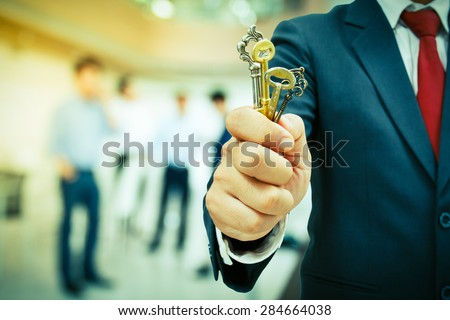 businessman showing the keys to success - stock photo