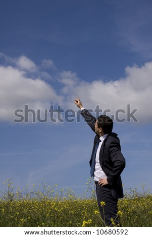 businessman showing the way to the future in perfect harmony with nature (with copy space)
