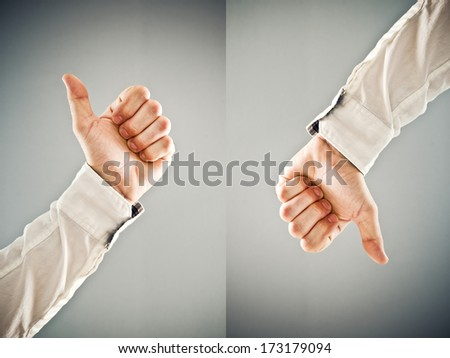 Businessman showing thumb down and thumb up symbol. Approval and disapproval concept. - stock photo