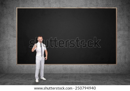 businessman showing thumb up and blank chalk board - stock photo