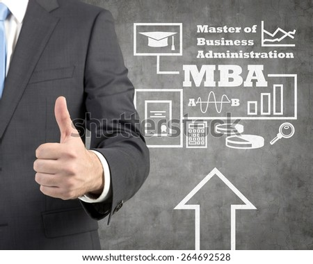 businessman showing  thumb up and drawing mba scheme on wall - stock photo