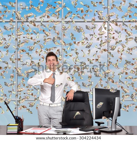 businessman showing thumb up and falling dollars banknote - stock photo